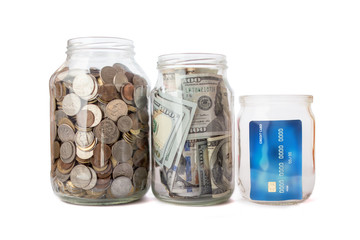 jar with coins and money, credit card