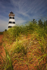 Lighthouse on a beach; Prince Edward Island, Canada
