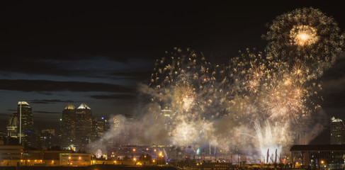 Fireworks in front of modern city skyline; Calgary, Alberta, Canada