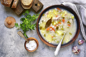 Rassolnik - traditional russian soup with pickled cucumber and c