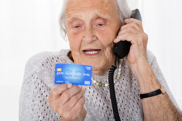 Senior Woman With Credit Card On Phone