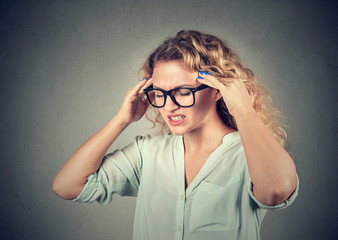 sad young woman in glasses with worried stressed face expression