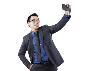 Businessman taking a selfie picture