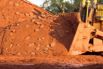 Bauxite mining in Weipa, Queensland, Australia Bauxite is an aluminium ore and is the main source of aluminium. Big bucket scoop bulldozer mining technology using to move bauxite mine.