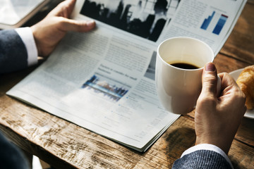 Reading Morning Paper Coffee Concept