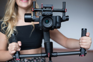 Professional  woman videographer with gimball video slr