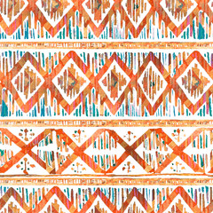 Watercolor ikat seamless pattern. Vibrant ethnic rhombus pattern in watercolour style.