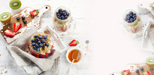 Breakfast with granola and berries in glass jar.  Healthy eating