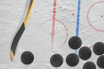 Sticks, pucks and hockey field with markings