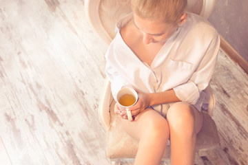 woman wakes up in the morning drinking hot tea