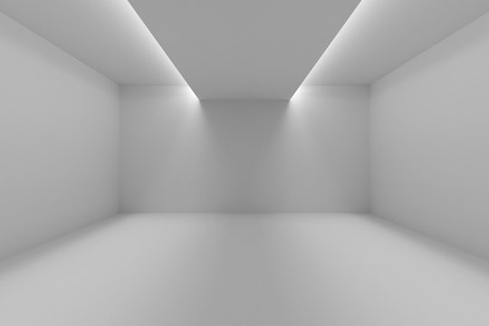 Empty room with white walls and lights in ceiling