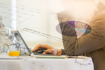 Financial and Investment concept. Double exposure of business man working with laptop computer and  Investment information chart.