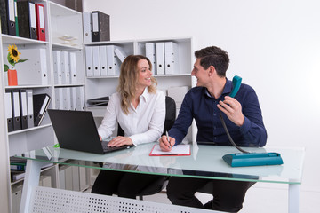 businessman and businesswoman working together in the office