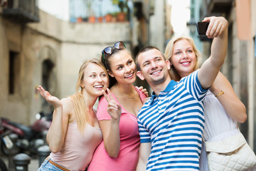 Friends taking self picture with mobile phone