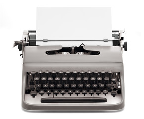 vintage typewriter with blank paper to type on
