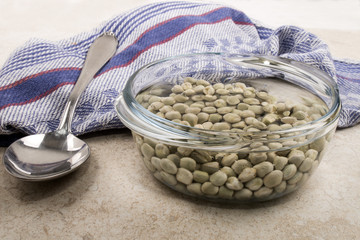 dried peas in a glass bowl with water