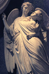 Marble statue of angelic couple in Florence, Italy