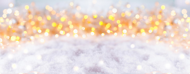 Abstract winter background with snow and golden lights  -  Panorama