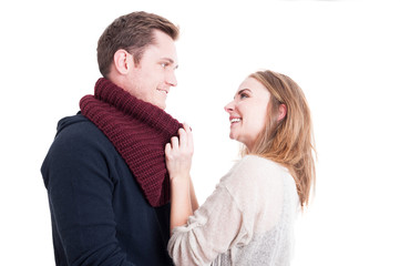 Woman arranging man's autumn casual neckcloth