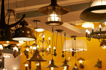 Many lights of glass and copper, hanging from the ceiling in the sales area. For the interior in the old style.
