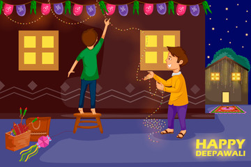 Kids decorating house for celebrating Diwali festival of India