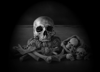 Skull and pile of bones in the dark Halloween night