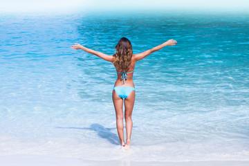 Woman in bikini walking to sea