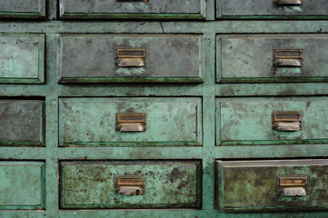 Green drawers of a workshop full of patina