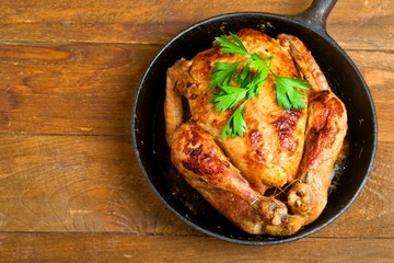 baked chicken,Style rustic.Selective focus.Top view, space for text.