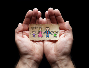Child drawing of family with the protection of cupped hands