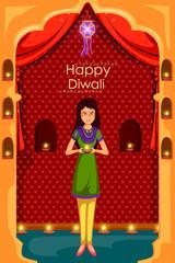 Lady with diya celebrating Diwali festival of India