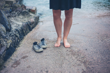 Barefoot woman with her shoes