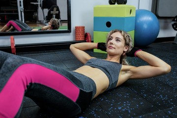 Beautiful woman performing exercise