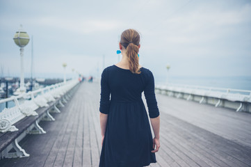 Young woman walking on the pier