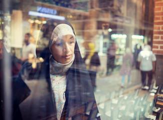 Beautiful Muslim woman spending time on traditional Iranian baza