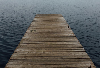 old wooden jetty on a lake