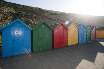 Brightly coloured beach huts in Whitby