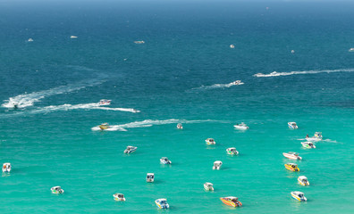 Top view of boats on beach with blue sea background