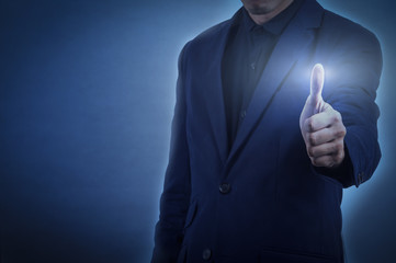 man in formal wear touching empty virtual glass thumb up  over dark blue background,business concept