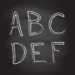 Hand drawn letters isolated on blackboard texture with chalk rubbed background. Vector illustration of alphabet.