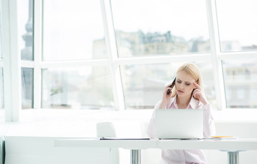 Young businesswoman sitting at office