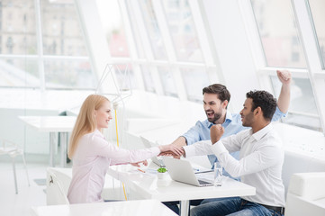 Young coworkers having brainstorming session in modern office