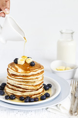Pancakes served with Blueberries and Maple Syrup