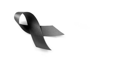 Black ribbon symbol for mourning on white background
