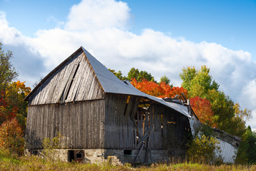 Old wooden barn in disrepair