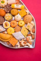 Indian assorted Sweets or sweet Food or mithai in decorative plate on diwali