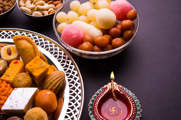 Mix Mithai or indian milk made sweets and diya on diwali festival