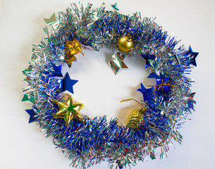 Shining and sparkling ribbon with fir tree toy inside. Blue ornament circle.