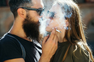 happy loving couple smoking