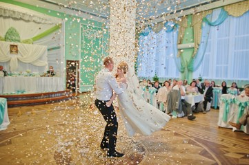 First wedding dance with gold confetti on restaurant